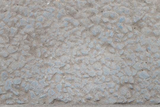 Light grey textured asphalt close up shot