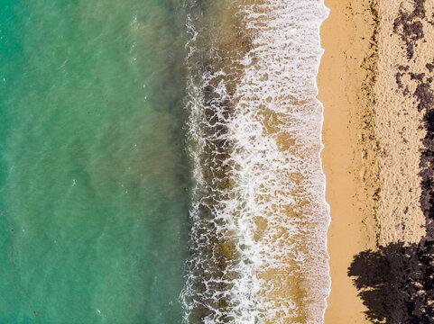 Waves crashing on a warm beach on a Caribbean island, USVI
