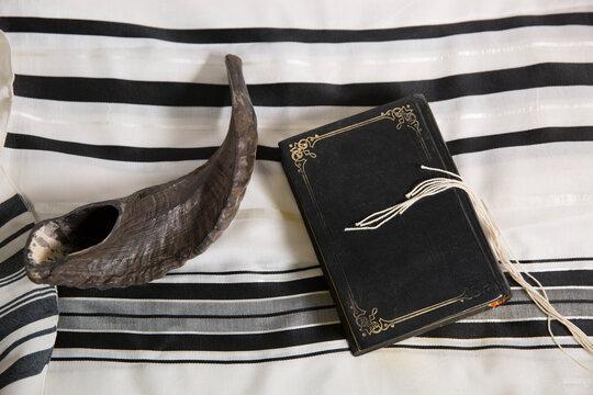 shofar, hebrew book and tallit