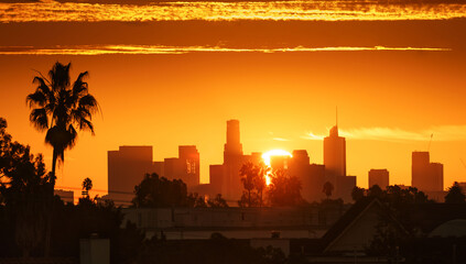 Fotobehang - Downtown Los Angeles Sunrise over city buildings silhouettes.