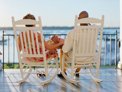 Rear view of couple sitting on deck