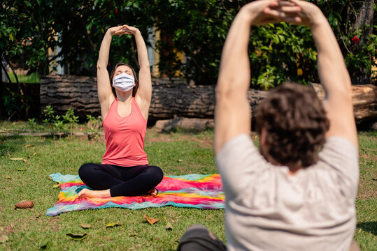 woman wearing mask on a fitness class outdoors