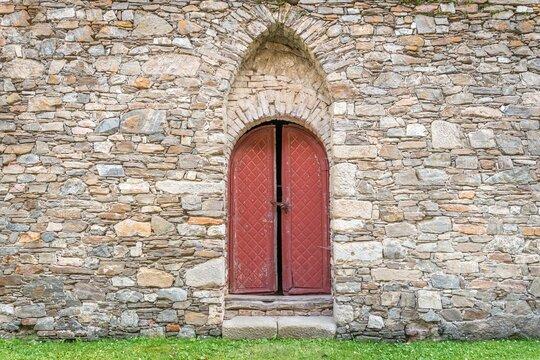 Medieval wooden door in old church