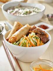 vietnamese bun thit nuong with spring rolls and grilled pork