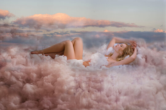Girl sleeping in the clouds.