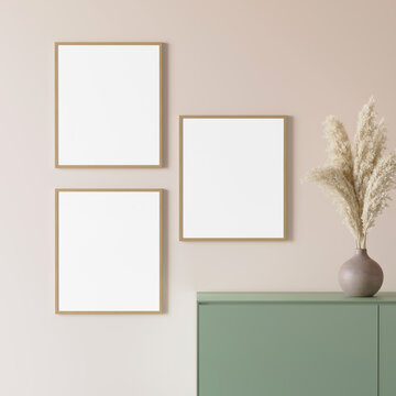 3d render of a light salmon red modern mockup interior with 3 wooden frames on an empty wall with a green sideboard and a ceramic vase with pampas grass