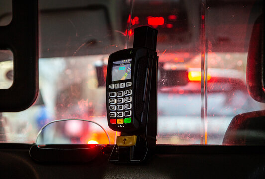 Credit card terminal in taxi car