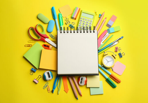 Blank notebook and school stationery on yellow background, flat lay with space for text. Back to school