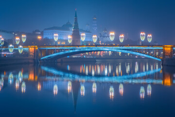 Winter Moscow. River in capital of Russia. Fog over the Moscow river. View of Great Kremlin Palace from Moscow River. Kremlin embankment. Capital of Russia in winter evening. Russian sights.