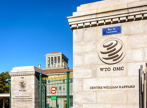 Geneva, Switzerland - September 3, 2020: Logo of The World Trade Organization (WTO), an organization dealing with regulation of international trade between nations, at the entrance of its headquarters