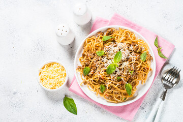 Pasta Bolognese in white plate top view.