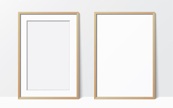 Set of 2 simple wooden frames leaning against the white wall. Blank elegant frame template. Picture frame vector mockup.