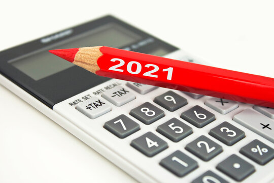 Calculator and red pen 2021