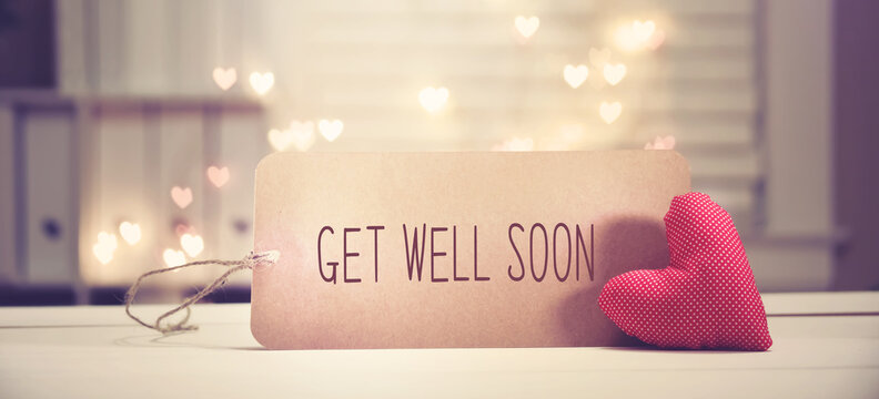 Get well soon message with a red heart with heart shaped lights
