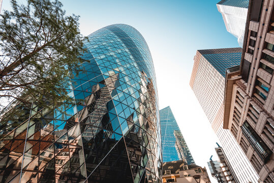 London, UK - October 18, 2019: Modern architecture 30 St Mary Axe building, also known as the Gherkin, and is an Iconic building in the City of London business district.