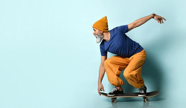 Stylish hipster bearded man with skateboard.