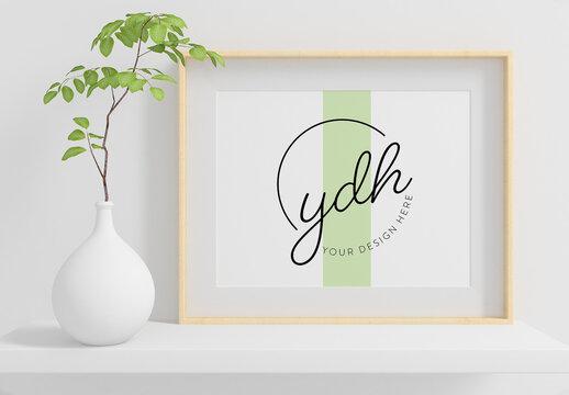 Horizontal Frame on a Shelf with Plant Mockup