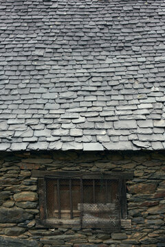 Detail of an slate roof of an old stone house