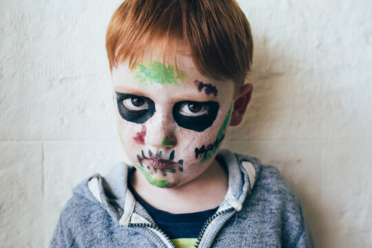 Child with face painted