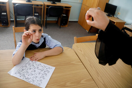 On International Day of Sign Languages, deaf Palestinian children learn to communicate