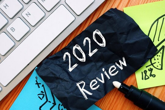 Financial concept about 2020 Review with inscription on the sheet.