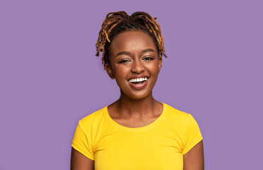 Young smiling african american woman over purple background