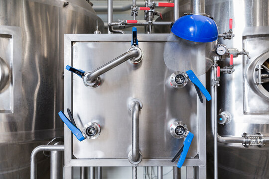 Stainless steel fermentation containers in a brewery