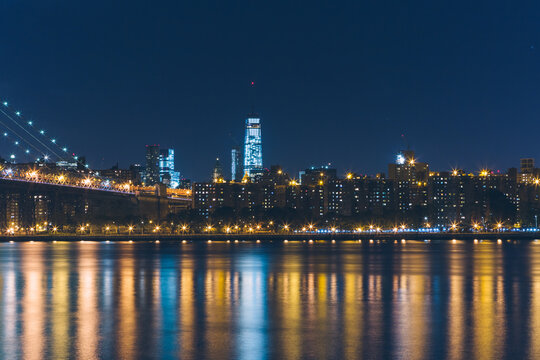 The New York City skyline at night with Brooklyn Bridge