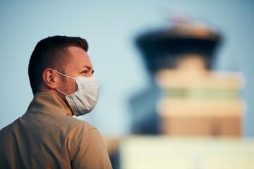 Man wearing face mask at airport