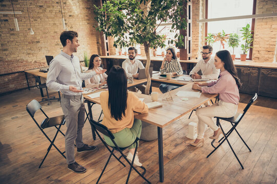 Photo of business men ladies successful people partners sit around table spacious office green tree expert guy tell future plans project professionals listening discussing startup indoors