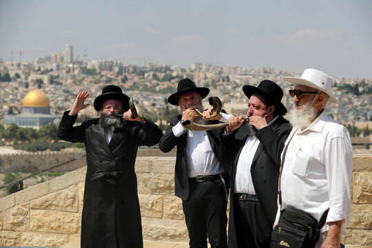 Ultra-Orthodox Jewish men blow Shofar's, a traditional ram's horn, ahead of Yom Kippur, the Jewish Day of Atonement, amid Israel's second nationwide lockdown to contain the spread of the coronavirus disease (COVID-19), in Jerusalem