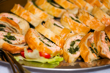 Fish strudel with spinach sliced in a bowl.