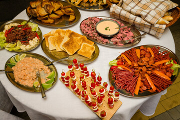 Trays of food on the table at the celebration.