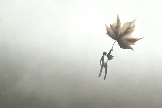 illustration of man flying away with a big autumnal leaf, surreal concept