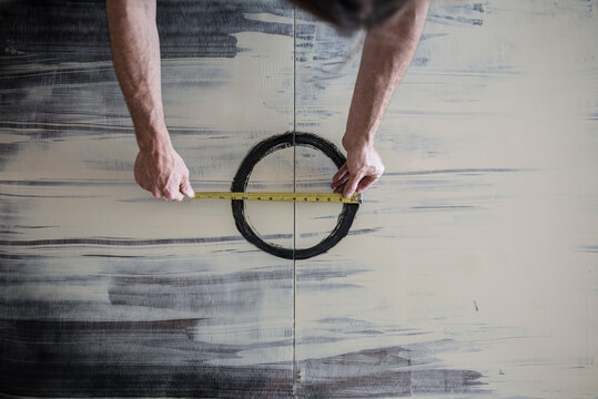 Artist Measuring Painted Circle
