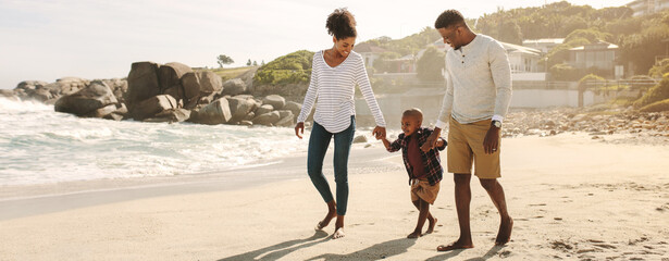 African family on beach walk