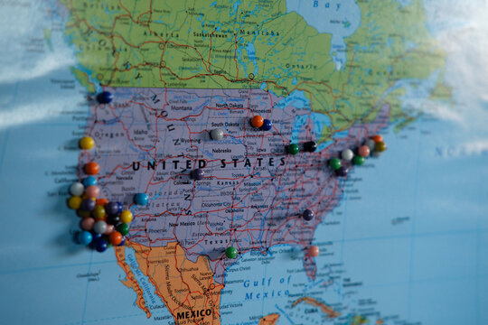Pins in a map of North America.