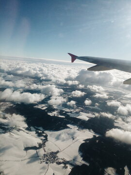 Aircraft window view to Alpes
