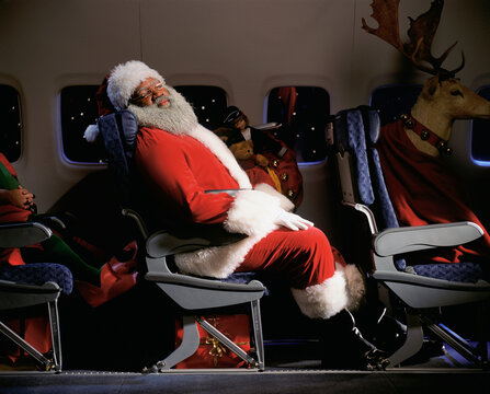 Santa Clause, reindeer and presents on an airplane