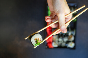 Photo sur Plexiglas Roe sushi rolls salmon fish flying fish roe vegetables ginger wasabi rice and nori on the table top view place copy space for text food background rustic