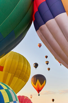 Bunch of colorful hot air balloons rising