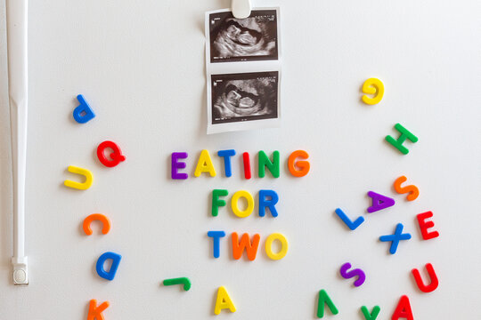 Fetal ultrasound image and magnetic letters on a fridge
