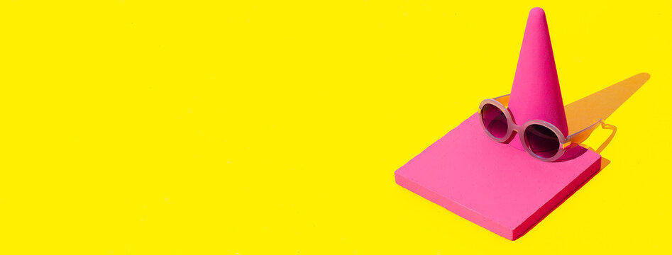 Minimal scene in isometric fashion abstract geometry objects and stylish accessory sunglasses in pink yellow colours. Shopping and sale concept