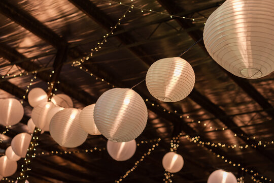 barn decorated for a part with lanterns and fairy lights