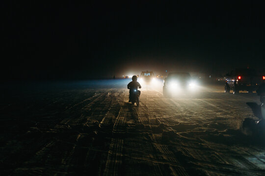 Motorcycle traveling on a foggy sand highway