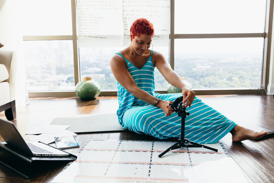 Black woman having virtual meeting at home during pandemic