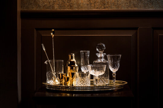 Vintage glassware and bar gear on a bar table