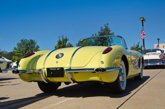 Rear view of a vintage, yellow 1958 Chevrolet Corvette Convertible classic car on October 19, 2013 in Westlake, Texas.