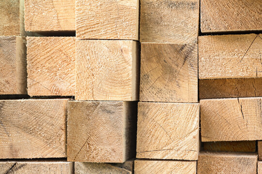 fresh cut stacked building lumber. natural wood texture