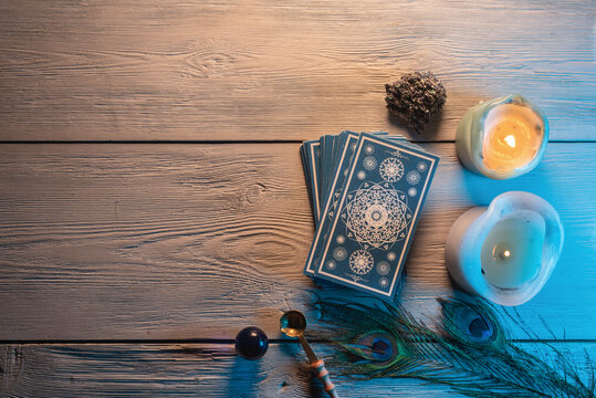 Tarot cards deck on the fortune teller desk table background. Future reading concept.